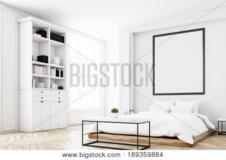 Corner of a white bedroom interior with a double bed a coffee table a bookcase near a wall and a vertical picture on the wall. 3d rendering mock up