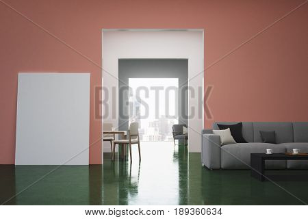 Pink and green living room interior with a gray sofa colored cushions lying on it and a vertical poster standing near a door. 3d rendering mock up