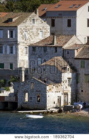 Old stone houses in town Vis in Croatia with front facade in the sea