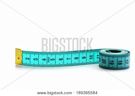 Roll Of Greenish Blue Measuring Tape Isolated On White Background