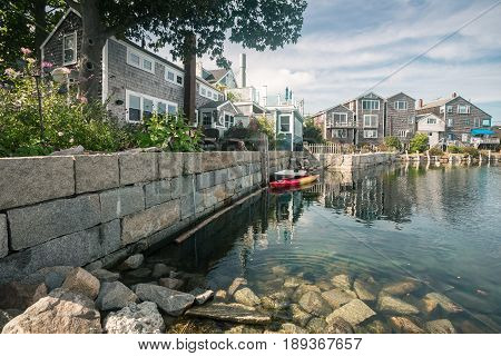Rear view of shops along the harbor in the small village of Rockport northeast of Boston MA.