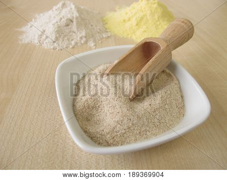 Ground psyllium seed husks, maize flour and buckwheat flour