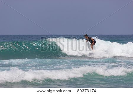 Single Surfer In The Ocean With Waves