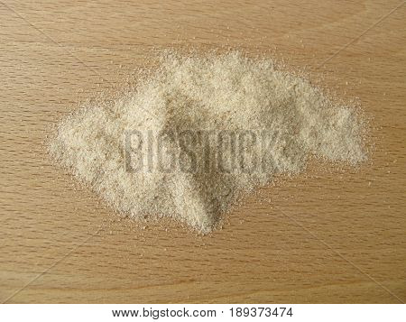 Ground psyllium seed husks on wooden board