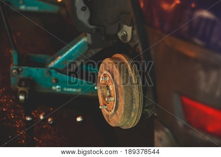 A Process Of New Tire Replacement, Disc Brake On Car, Repair In Garage, Automotive Service Station,