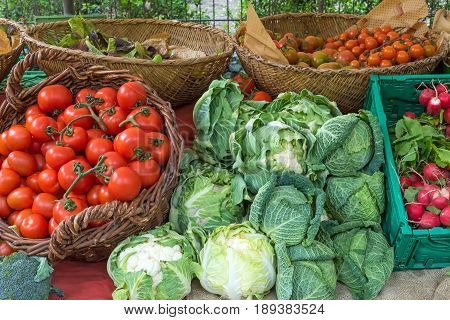 Tomatoes, cabbage and cauliflower for sale at a market
