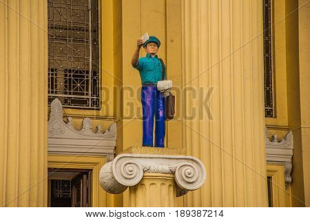 Sculpture Of A Postman At The Post Office Building Manila. Philippines.