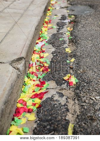 Rest of confetti on the street after the party