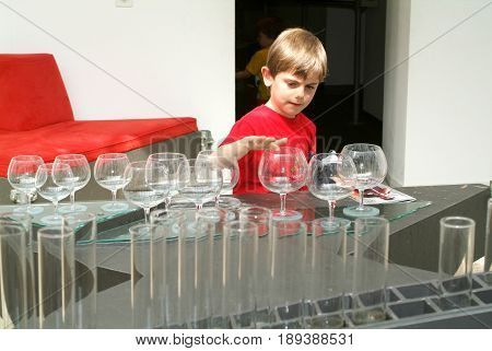 Child Making Music With Glasses