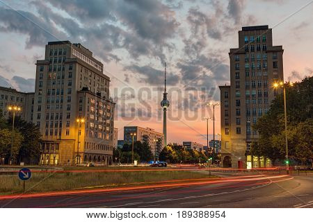 Strausberger Platz in Berlin after sunset with the Television Tower in the back