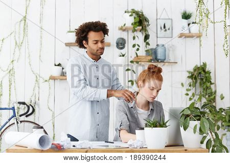 Overwork Concept. Indoor Portrait Of Tired Redhead Caucasian Student Female Working At Laptop Enjoyi