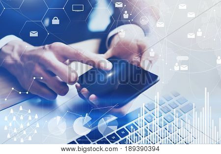 Closeup view of Male hand pointing finger on mobile phone touch display.Businessman working at office on modern notebook.Concept of digital diagram, graph interfaces, virtual screen, connections icon