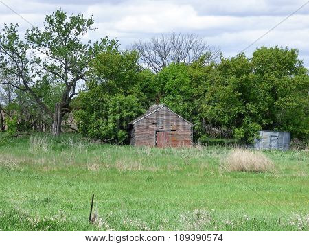 An abandoned storage building on a abandoned farmstead.