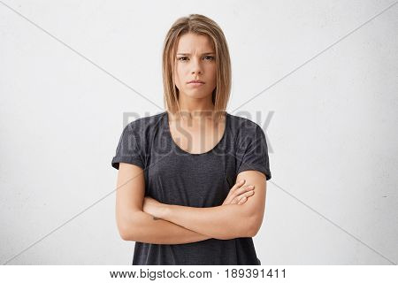 Waist Up Shot Of Beautiful Irritated Young Woman With Bob Haircut Holding Her Arms Crossed, Having S