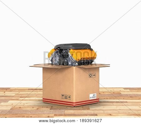 Engine In A Cardboard Box Concept Of Sale And Delivery Of Auto Parts On Wood Floor And White Backgro