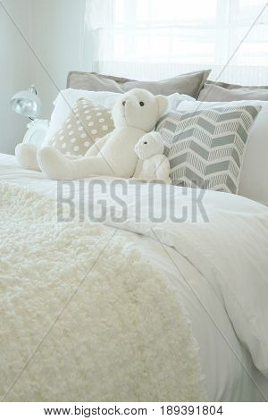 Kid Bedroom With Puffy Teddy Bear On Bed