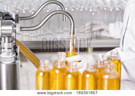 Producing Of Beauty An Healthcare Products. Researcher In Protective Wear Standing In Laboratory At
