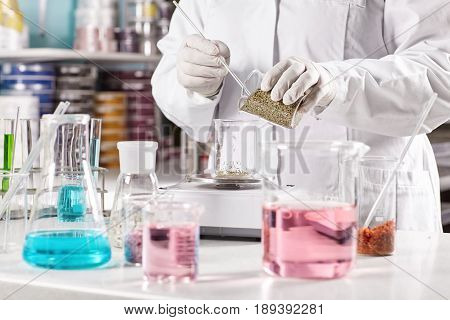 Equipped Doctor Making Dermatology Products In Laboratory. Researcher Wearing White Gown And Gloves