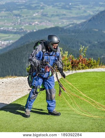 Bavarian Alps, Germany - September 2016: Paragliding in the Alps on a sunny day