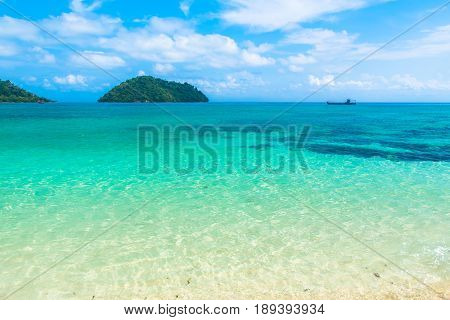 Holiday in Thailand - Beautiful Island of Koh khai island in Koh Lipe with long tail boat by the beach at Satun Thailand.