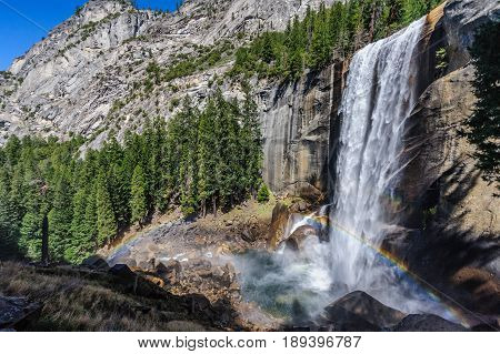 Rainbow in front of Vernal Falls, Yosemite National Park, USA, in early spring. b