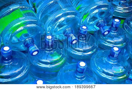 Big plastic bootles of still water. Water background