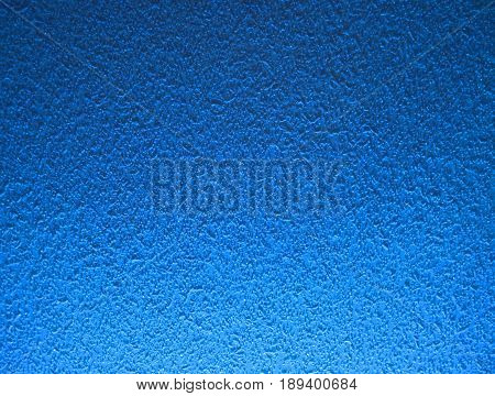 blue dark background.Wall with ice. Blue snow.