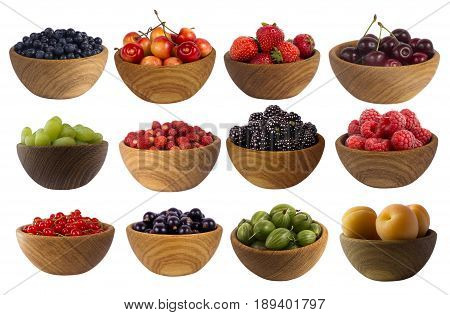 Collage of different fruits and berries isolated on white. Set of strawberries raspberries currants blackberries gooseberries apricots blackberries grapes and cherries. Sweet and juicy berry with copy space for text. Ripe strawberries close-up. Background