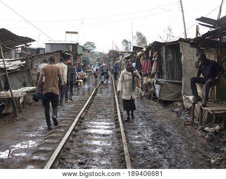 KIBERA, KENYA-NOVEMBER 5, 2015: Unidentified people live and work in Kibera, Kenya. Kibera is the largest urban slum in Africa.