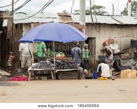 KIBERA, KENYA-NOVEMBER 6, 2015: Unidentified people work at a vegetable stand in Kibera, the largest urban slum in Africa.