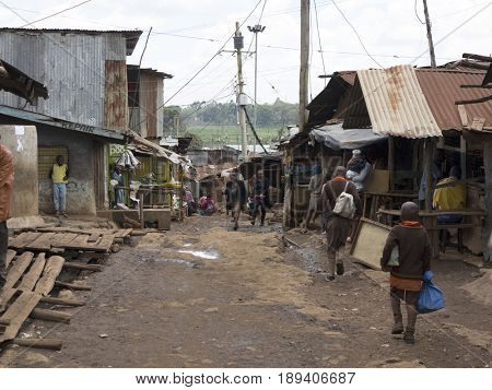 KIBERA, KENYA-NOVEMBER 5, 2015: Unidentified people work and live in Kibera, Africas largest urban slum.