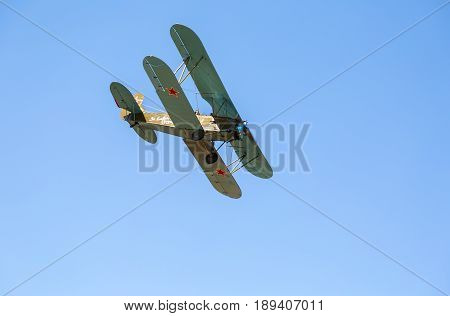 Samara Russia - April 30 2017: Retro Russian aeroplane Polikarpov PO-2 in the blue sky. Text in russian: For friends of fight
