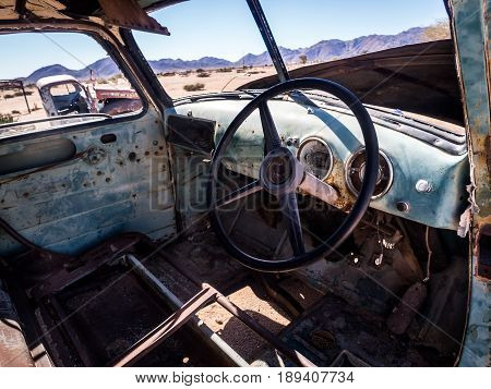 SOLITAIRE NAMIBIA - JUNE 18 2016: Old Ford car wreck left in Solitaire on the Namib Desert Namibia.