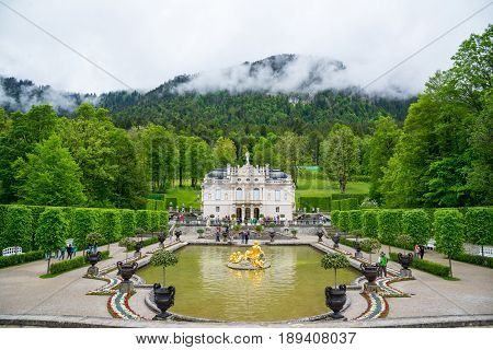 Bavaria, Germany - June 5, 2016: Front view of the Linderhof Palace with beautiful fountain, Southwest Bavaria, Germany