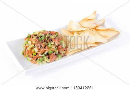 salmon tartare with granny smith apple avocado and wonton chips