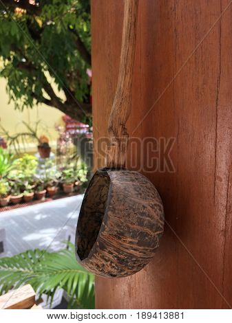 Thai Dipper From Coconut Shell Water Ladle On The Wooden Pole, Kitchen Utensil Handicraft Handmade.