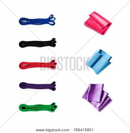 Collection of different exercise bands for fitness, bodybuilding and rehabilitation isolated on white background