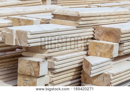 Wooden logs material for new house - construction site.