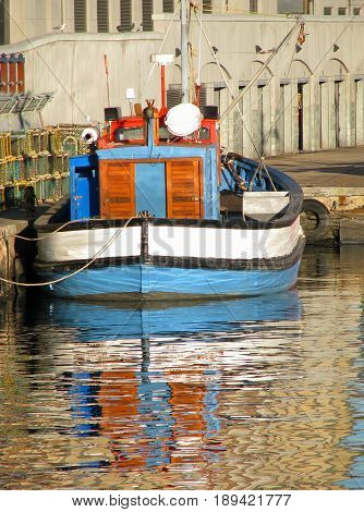 FROM THE VICTORIA AND ALFRED WATERFRONT, CAPE TOWN SOUTH AFRICA, BOAT, REFLECTING IN THE WATER