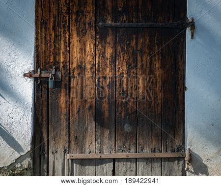 Old door in Skansen open-air museum and zoo in Sweden Stockholm. Old swedish traditional village. Scandinavia Europe.