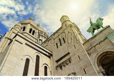 Angle view of Basilica Sacre Coeur Roman Catholic Church and minor basilica dedicated to Sacred Heart of Jesus Paris France