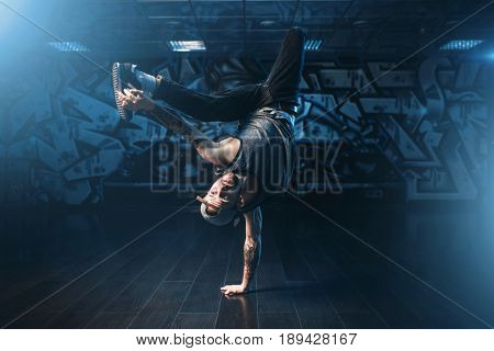 Breakdance action, dancer posing in dance studio