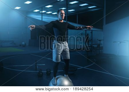 Man on training, balance workout with bouncy ball