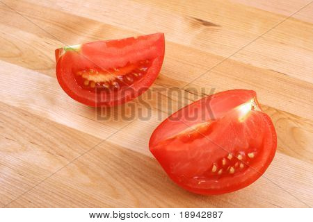 tomato on wooden kitchen board