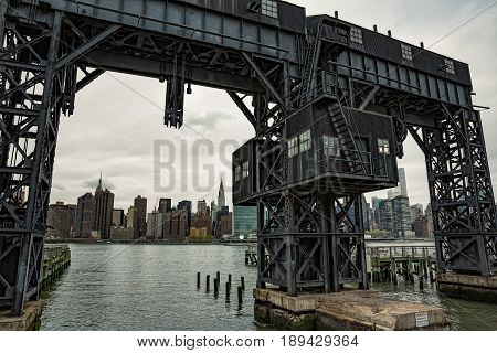 Abandoned Gantry With City View Behind.