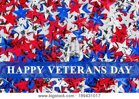 Happy Veterans Day text over red white and blue stars background