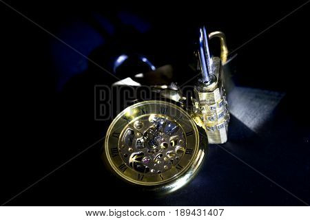 time and security with an old clock and a padlock