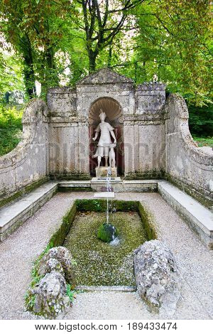 The trick fountain in Hellbrunn palace Salzburg Austria. Artemis's statue in the park of fountains.