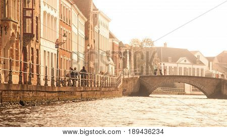Medieval houses along canals of Bruges in autumn time, Belgium.