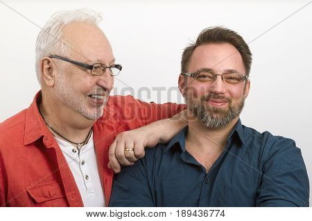 Gay couple looking happy - on bright background